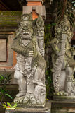 Traditional demon guards statue carved in stone in Bali. Architecture. Stock Images