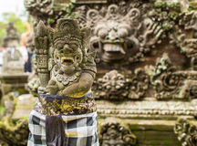 Traditional demon guards statue carved in stone on Bali. Indonesia. Stock Photography