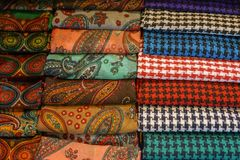 Traditional design Turkish carpets and scarfs. A length or square of fabric worn around the neck or head Royalty Free Stock Photography