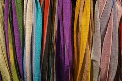 Traditional design Turkish carpets and scarfs. A length or square of fabric worn around the neck or head Royalty Free Stock Photos
