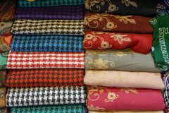 Traditional design Turkish carpets and scarfs. A length or square of fabric worn around the neck or head Royalty Free Stock Photo