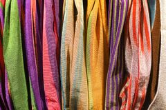 Traditional design Turkish carpets and scarfs. A length or square of fabric worn around the neck or head Stock Images