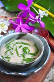 Traditional Dessert Cendol Serve in Bowl. Decorated with orchid on background stock photography