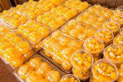 Traditional Dessert. Traditional Thai Dessert in plastic box on shelf .Egg yoke fudge balls cooked in syrup, Golden threads, Bean-paste royalty free stock image