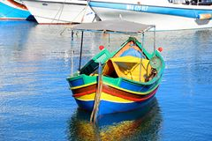 Traditional Dghajsa fishing boat, Gozo. Colourful traditional Maltese Dghajsa fishing boat moored in the harbour, Mgarr, Gozo, Malta, Europe Stock Photo