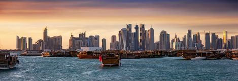 The traditional Dhow harbor in front of the modern skyline of Doha, Qatar Royalty Free Stock Photography