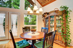 Traditional dining area with wooden table set and hardwood floor. Royalty Free Stock Photo