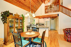 Traditional dining area with wooden table set and hardwood floor. Stock Image