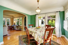 Traditional dining area with wooden table set. Open floor plan. Royalty Free Stock Photos