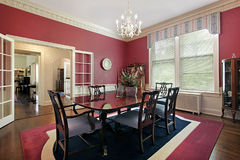 Traditional dining room. With red walls Stock Images