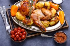 Traditional dinner baked chicken and potato Stock Photos