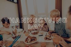 Traditional Dinner. Have Fan. Family. Cups of Tea. Holiday. Blue Shirt. Baked Turkey. Happy Family. Thanksgiving Day. Together at Home. Autumn Feast royalty free stock photography