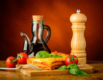 Traditional dinner with lasagna bolognese stock photography