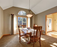 Traditional dinning room with carpet, in beautiful northwest hom Stock Images