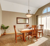 Traditional dinning room with carpet, in beautiful northwest hom Stock Photo