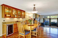 Traditional dinning room with hardwood floor, in beautiful home. royalty free stock image