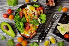 A traditional dish of American cuisine Cobb Salad. Healthy Cobb Salad. A traditional dish of American cuisine, Cobb Salad with chicken, bacon, avocado and egg stock image