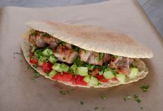 Cypriot Souvlaki in Pitta Bread. A traditional dish from cyprus. Pork kebab is grilled on charcoals and then served in Pitta bread with salad royalty free stock photos