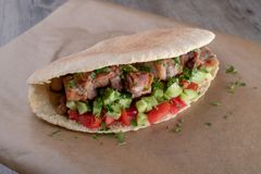 Cypriot Souvlaki in Pitta Bread. A traditional dish from cyprus. Pork kebab is grilled on charcoals and then served in Pitta bread with salad stock image