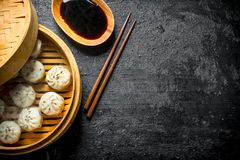 Traditional dish. Hot dumplings of manta with meat. On black rustic background stock images