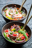 Traditional dish with seafood and noodles Royalty Free Stock Image