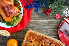 Traditional dish turkey on the holiday table. Festive dinner for Thanksgiving or Christmas.  royalty free stock photo