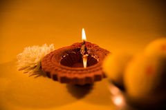 Traditional diya lamp lit on colorful rangoli in diwali Stock Photography