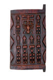 African Carved Window. Traditional Dogon Granary window hand carved from Mali, Africa stock image