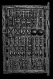 African carved window. Traditional Dogon Granary window hand carved from Mali, Africa, processed in black and white royalty free stock photos