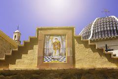 Traditional dome with blue ceramic tiles and the image of the saint in the church Relleu, Alicante province.  royalty free stock images