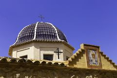 Traditional dome with blue ceramic tiles and the image of the saint in the church Relleu, Alicante province.  stock image