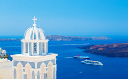Traditional dome of the Church on background Caldera, cruise ship and sea Stock Image