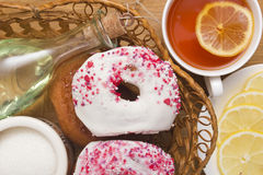 Traditional donuts fried in oil Stock Images