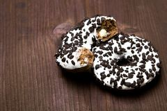 Traditional donuts on wooden background. Tasty doughnuts with icing, copy space Royalty Free Stock Photos