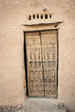 Traditional door, Bandiagara Escarpment. Traditional wooden door with decorations in a Dogon village, Mali, Africa Royalty Free Stock Image