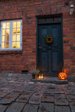 Traditional door with cobblestone street and halloween decoratio Royalty Free Stock Photo