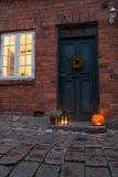 Traditional door with cobblestone street and halloween decoratio Royalty Free Stock Photo