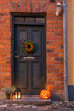 Traditional door with halloween decorations Stock Photo
