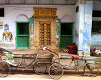 Traditional door and Cycle Rickshaws royalty free stock photography
