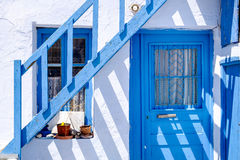 Traditional doors and windows in Greek white and blue style Royalty Free Stock Photos