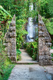 Traditional double stone gate on waterfall Stock Images