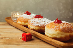 Traditional doughnuts for Jewish Holiday Hanukkah. Selective focus on the doughnut in the middle Royalty Free Stock Image