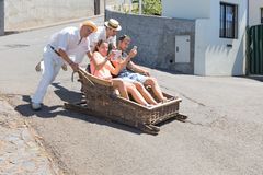 Traditional downhill sledge trip in Madeira, Portugal. FUNCHAL, MADEIRA - AUG 13: Traditional downhill sledge trip on August 13, 2014 in Madeira, Portugal. A stock photo