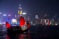 Traditional Dragon Boat in Hong Kong Harbor. Traditional Junk Boat in Hong Kong Harbor Stock Photo