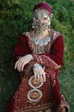 Traditional dress. Ethnic village girl wearing Middle Eastern clothing Stock Images
