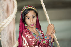 Traditional dressed girl in Oman Stock Photos
