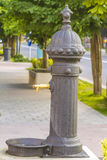 Traditional drinking water fountain with water drop Royalty Free Stock Photography