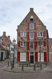 Traditional Ducht house with red window shutters Stock Photography