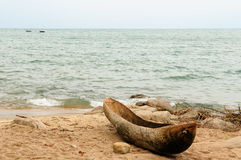 Traditional dugout canoe on the beach on the lake Malawi Royalty Free Stock Images