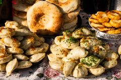 Traditional dumplings with fried onions at a street food festival. Traditional Ukrainian dumplings with fried onions at the festival of street food royalty free stock images